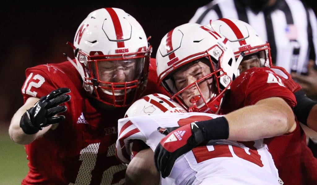 Nebraska linebackers Luke Gifford (12) and Chris Weber tackle Wisconsin running back Jonathan Taylor during second half action Saturday night at Memorial Stadium.