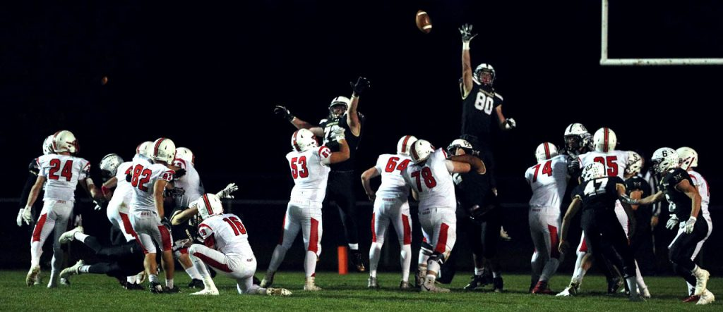 Riley Schliep (88) jumps in the air trying to block a point after touchdown attempt by Aurora
