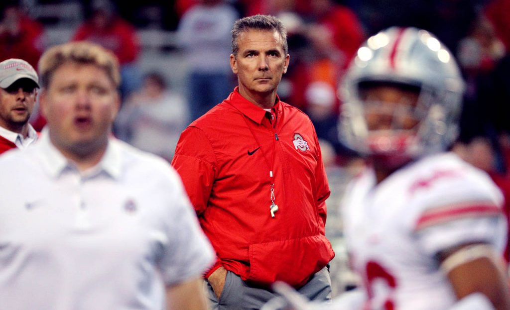 Ohio State head coach Urban Meyer watches his his players warm up as they prepare to play Nebraska Saturday night at Memorial Stadium. (Independent/Andrew Carpenean)