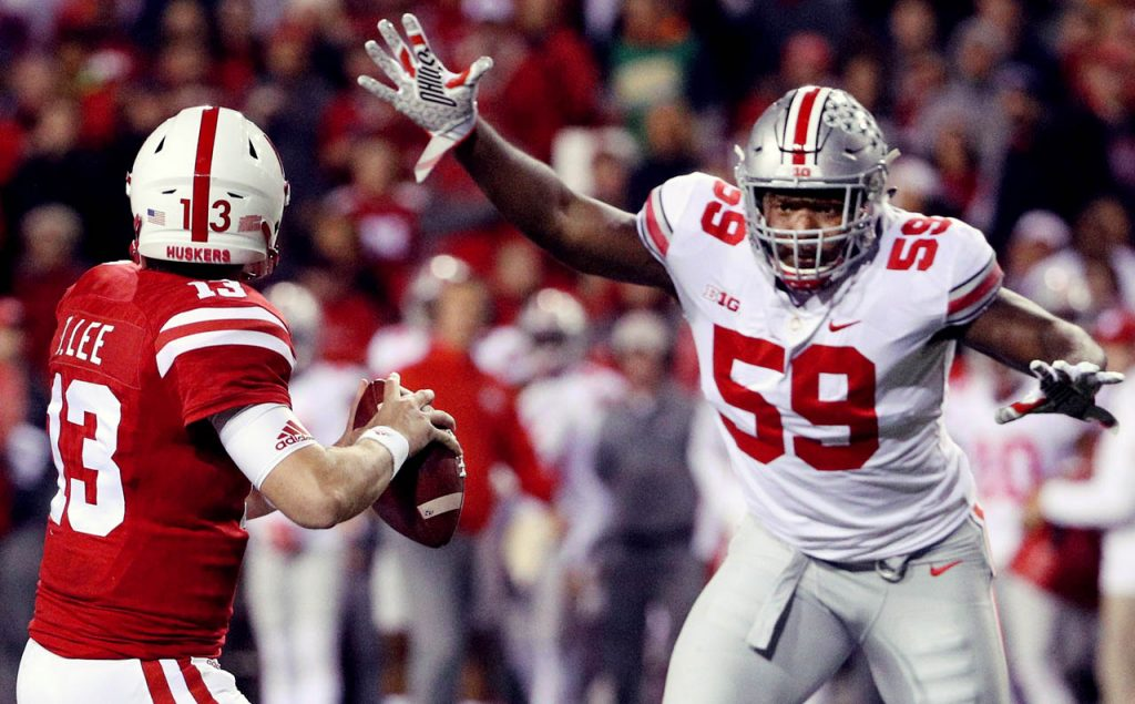 Ohio State defensive end Tyquan Lewis pass rushes Nebraska quarterback Tanner Lee Saturday night at Memorial Stadium. (Independent/Andrew Carpenean)