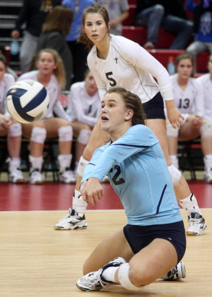 Grand Island Central Catholic junior Jenny Lowry gets a dig during the Class C1 State Volleyball Championship against Wahoo at the Bob Devaney Sports Center Saturday.