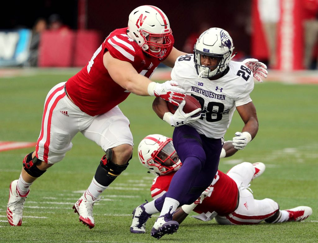 Northwestern running back Justin Jackson breaks a tackle by Nebraska linebacker Avery Roberts as he scores a touchdown in the second quarter at Memorial Stadium Saturday.