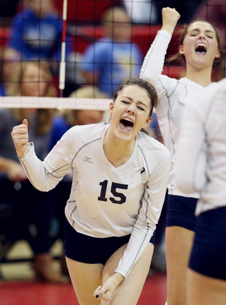 Grand Island Central Catholic junior Kamryn Willman celebrates a point during the Class C1 State Volleyball Championship against Wahoo at the Bob Devaney Sports Center Saturday.