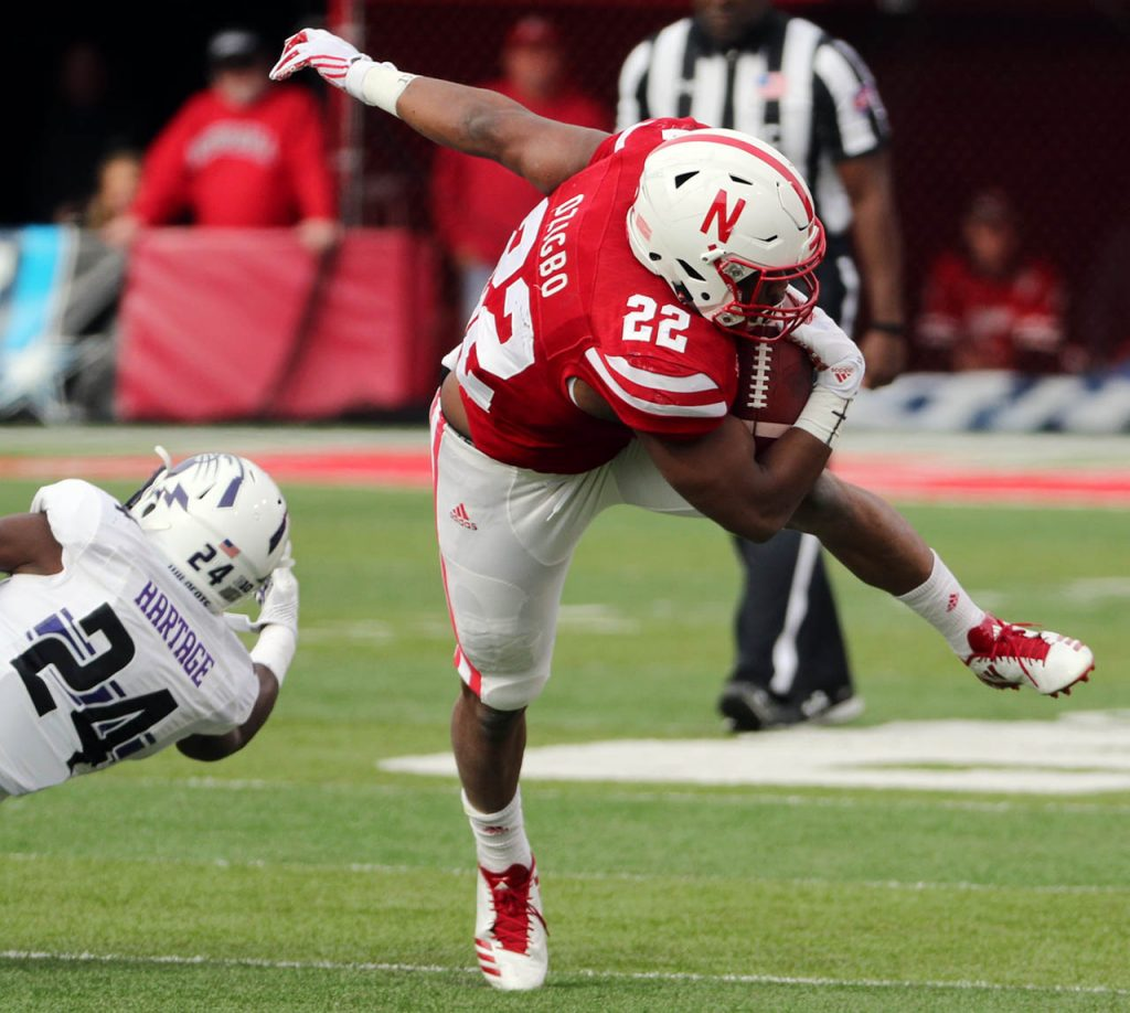 Northwestern cornerback Montre Hartage upends running back Devine Ozigbo during a Huskers first quarter drive.