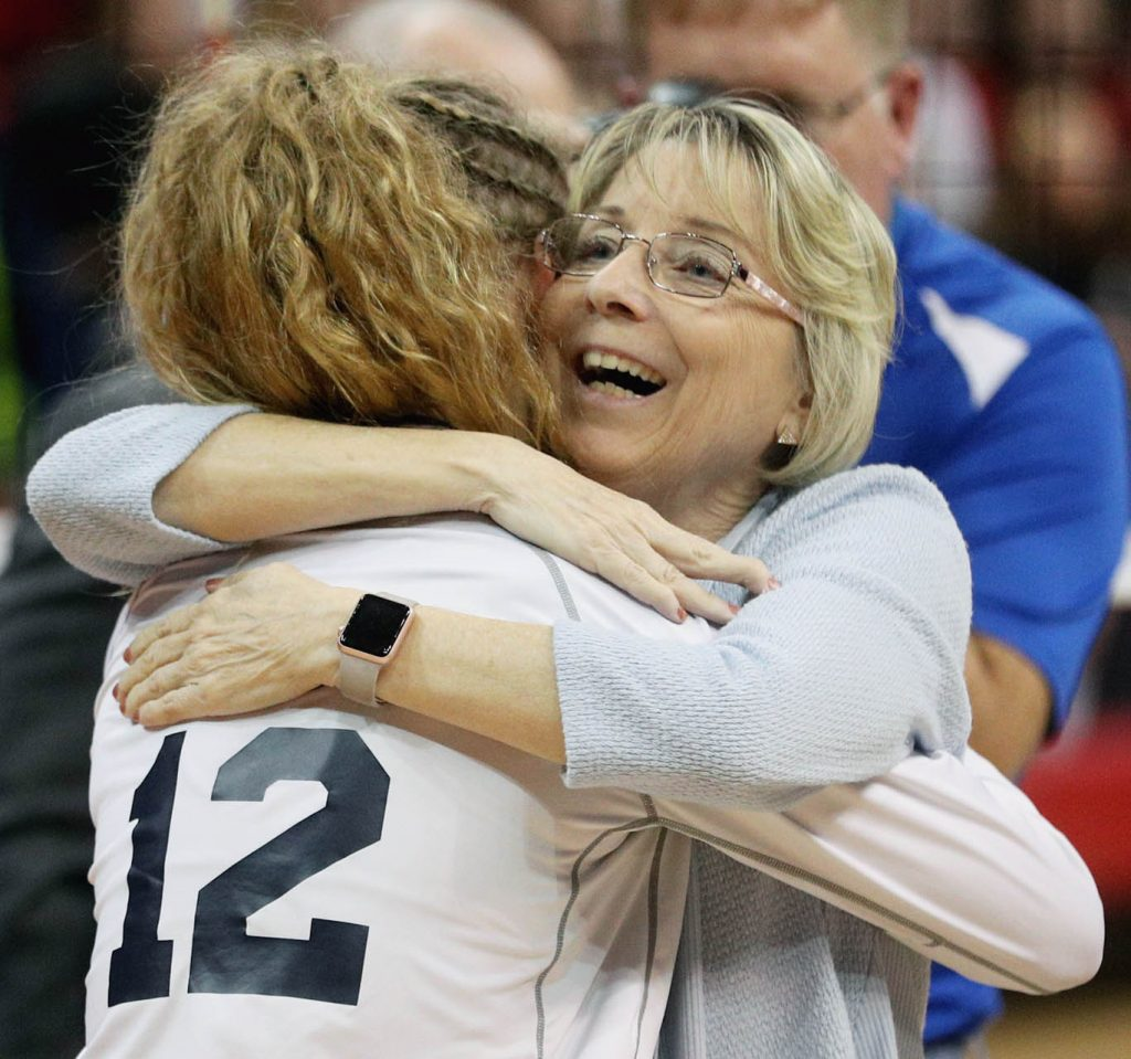 Grand Island Central Catholic head coach Sharon Zavala hugs her lone senior on the team Ali Nowicki concluding the Class C1 State Volleyball Championship against Wahoo at the Bob Devaney Sports Center Saturday. Wahoo beat Central Catholic in three straight sets. (Independent/Andrew Carpenean)