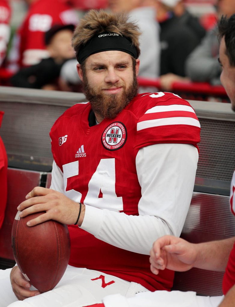 Huskers longsnapper Jordan Ober smiles while talking with a teammate prior to kickoff against Northwestern.