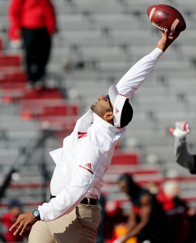 Nebraska cornerbacks coach Donte Williams makes a one-hand snag while catching a pass as players warm up to play Northwestern.