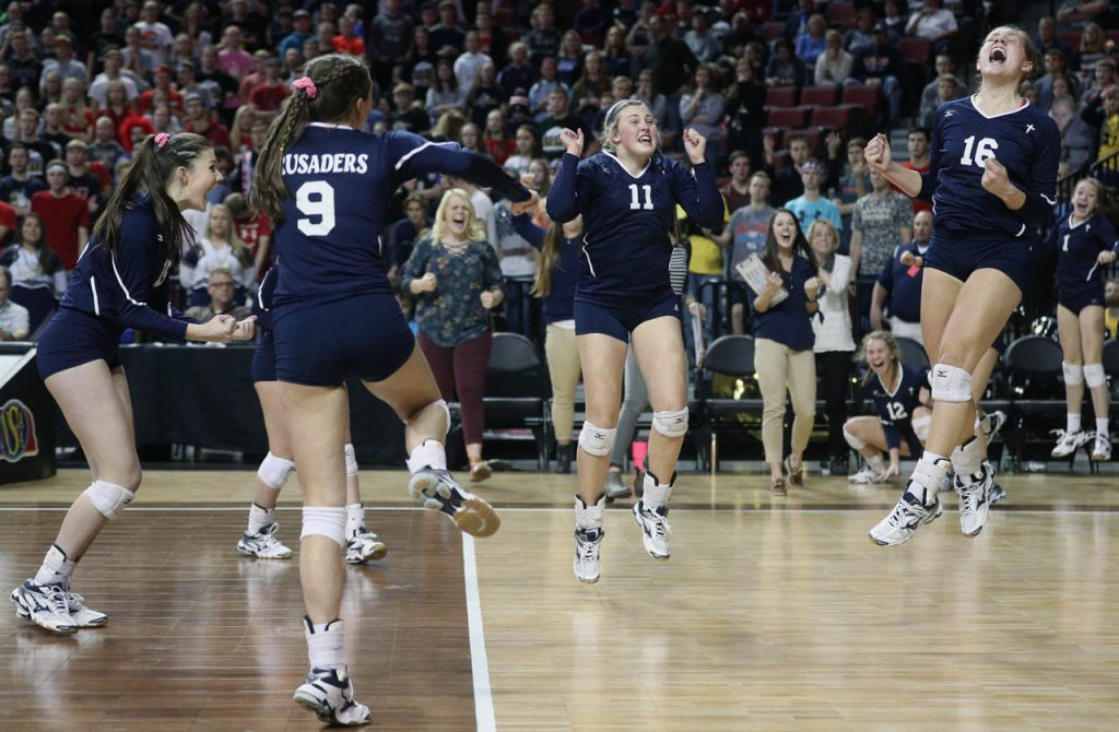 Grand Island Central Catholic volleyball players celebrate a point against Lincoln Lutheran at Pinnacle Bank Arena.
