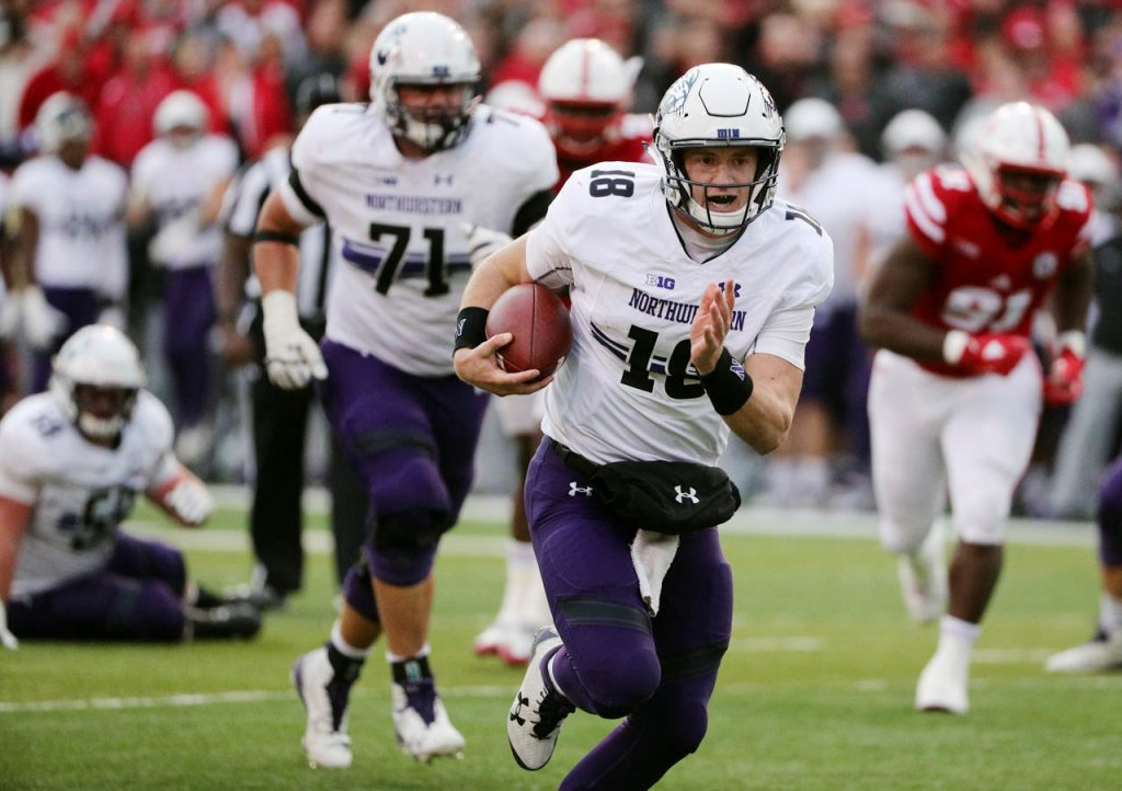 Northwestern quarterback Clayton Thorson scores on a touchdown run against Nebraska at Memorial Stadium Saturday.