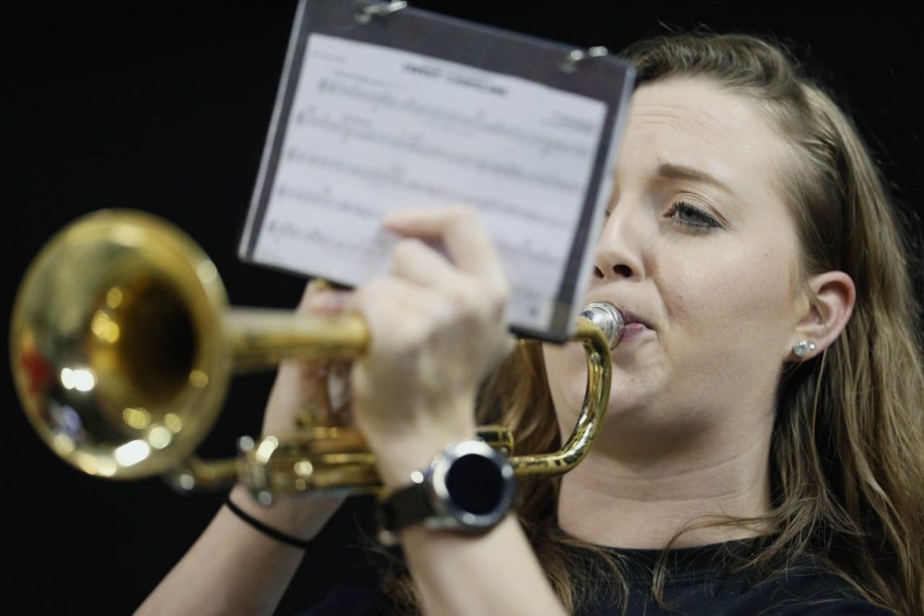 Brigit Baglien, music director at Grand Island Central Catholic, performs with the band prior to the Class C1 semifinal against Lincoln Lutheran at Pinnacle Bank Arena Friday.