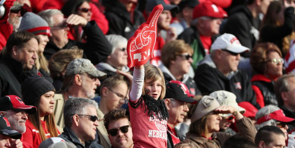 A lone Huskers fan raises her number one foam finger during the Nebraska vs. Northwestern football game.