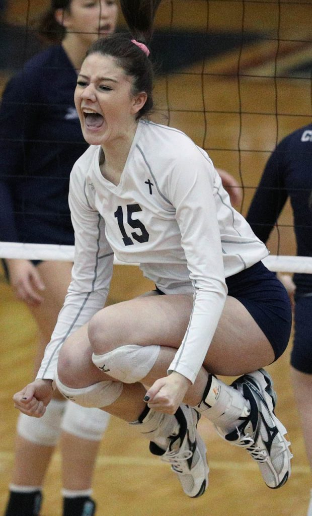Grand Island Central Catholic junior Kamryn Willman celebrates her match point kill to beat Omaha Concordia 25-21 in the first set Thursday at Lincoln North Star High School.