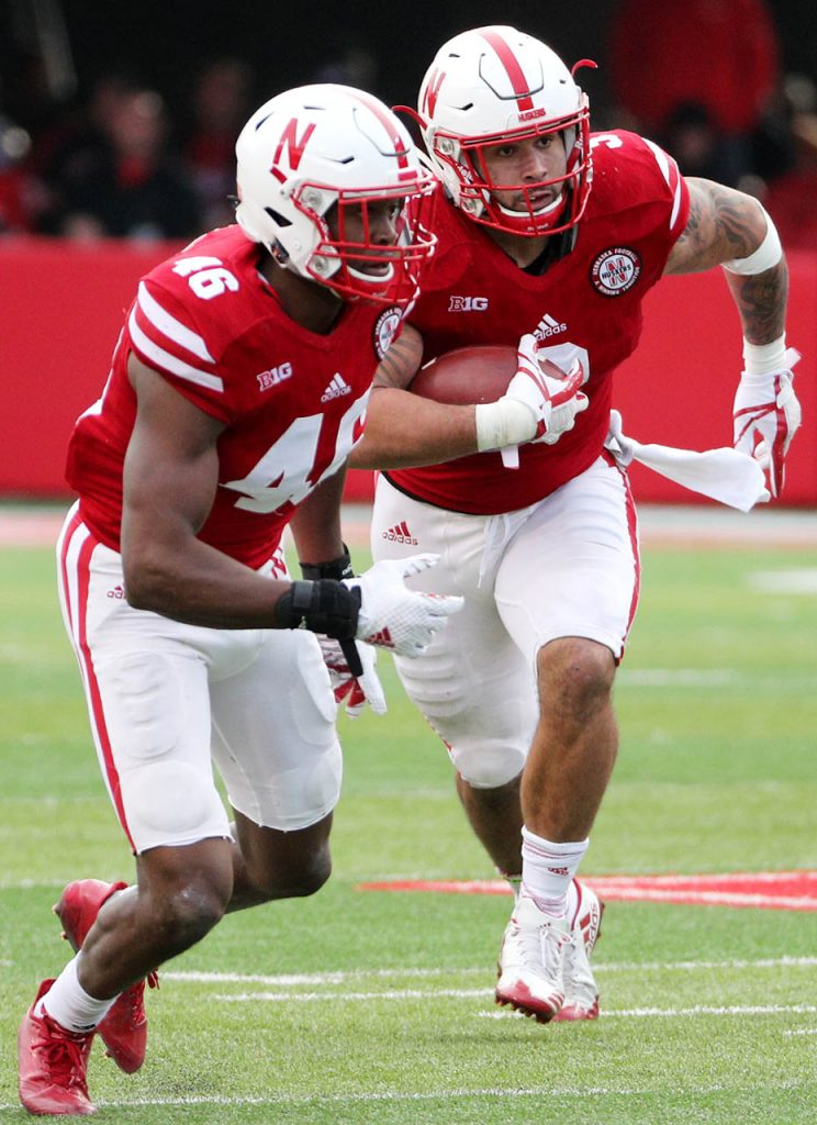 Nebraska linebacker Marcus Newby, right, gets a pick six touchdown against Northwestern as teammate Joshua Kalu (46) turns up field at Memorial Stadium Saturday.