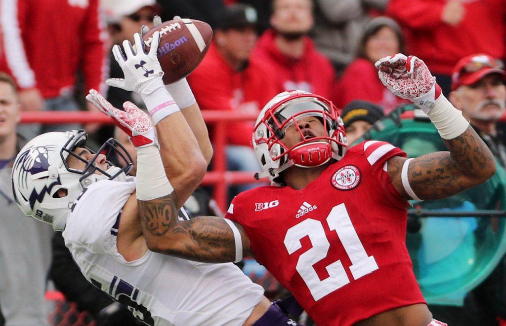 Northwestern wide receiver Macan Wilson catches the ball while defended by Nebraska defensive back Lamar Jackson at Memorial Stadium Saturday.