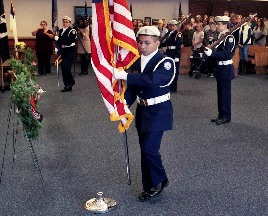 USAFROTC cadet Angel Cavazos retires colors at the end of the Wreaths across America ceremony inside All Faiths Chapel Grand Island Veterans Home.