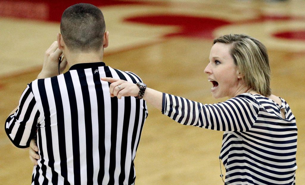A referee gets an earful from Hastings College head coach Jina Johansen during the GPAC Quarterfinal Women's Tournament game at Lynn Farrell Arena Wednesday night.