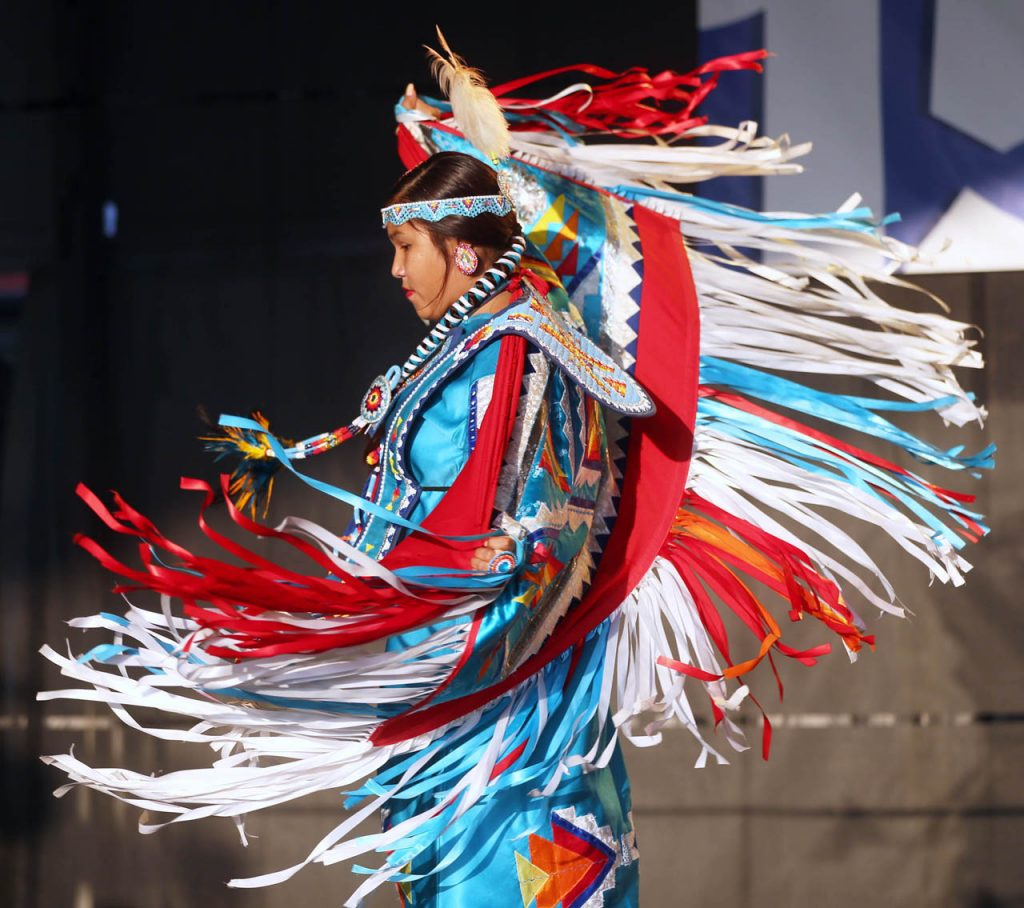 4PP: Marysa Dominquez, a Sicanju Lakota Indian from Lincoln, dances on the Family Fun Zone Stage as a member of the Many Moccasins Dance Troupe at the Nebraska State Fair Friday.