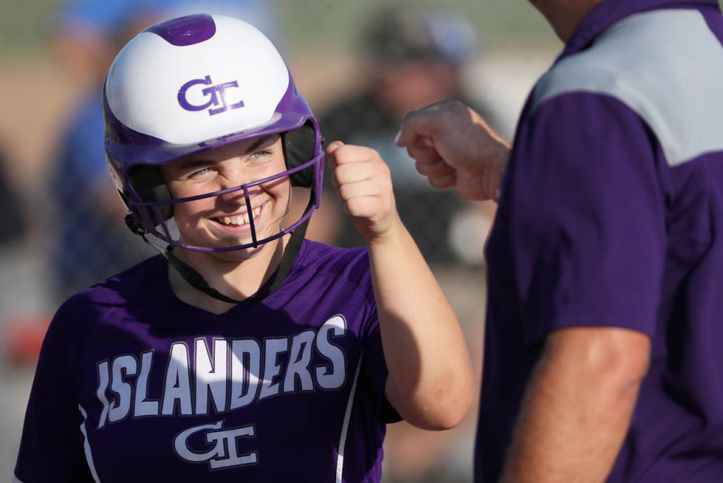 Grand Island sophomore Kamryn Kier goes back to the dugout with a smile and a fist bump to her coach after hitting a homerun against Lincoln East Thursday at the Veterans Complex.