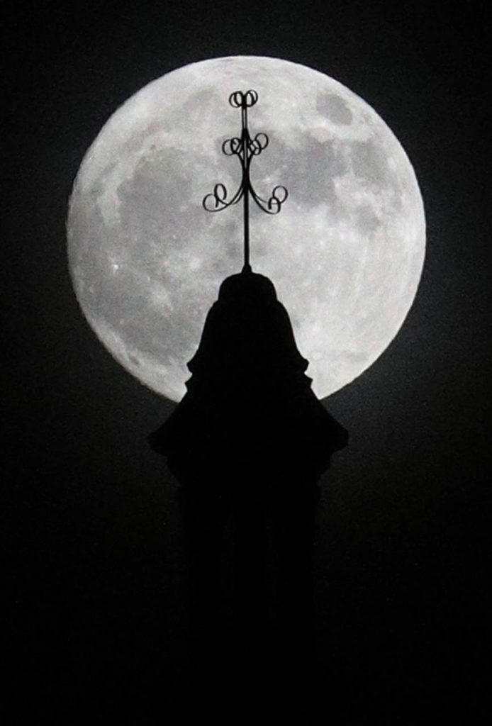 A super moon rises above the steeple on the Hall County Courthouse late Saturday afternoon.